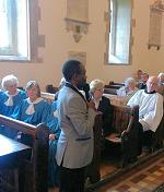 Edgar addressing congregation